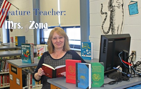 Mrs. Zong poses with her favorite books during Read Across America Week.