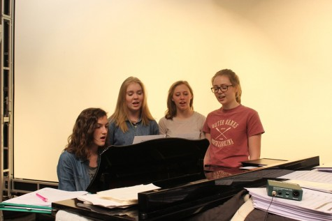 Stephanie Mills, Grace Misera, Addison Clemente, and Hailey McCloskey sing in the auditorium during a study hall. It