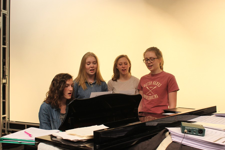 Stephanie Mills, Grace Misera, Addison Clemente, and Hailey McCloskey sing in the auditorium during a study hall. It's one of the many ways B-A students benefit from music during the school day.