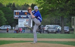 Nevin Wood winds up before throwing a pitch
