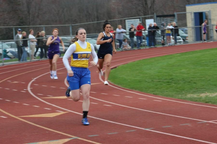 Senior Marissa Panasiti rounds into the home stretch to win the 400 meter run yesterday against Hollidaysburg and Bishop Guilfoyle.