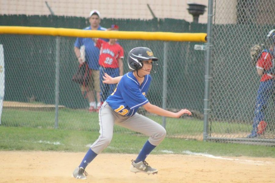 Ali Dumin turns to make it back to first yesterday against West Branch.