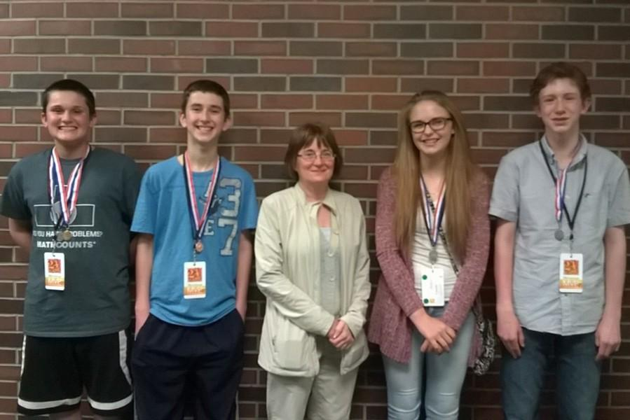 B-A middle school students recently competed in a 24 game competition. Pictured are: (l to r) Jack Luensmann, Caedon Poe, Mrs. Kathy Taylor, Cassidy Troutman, and Sam Gormont.
