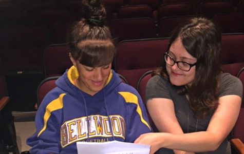 Laycee Clark and Kerri Little practice in the auditorium to deliver their Commencement addresses. Graduation ceremonies take place Thursday starting at 7 p.m. at Memorial Stadium.