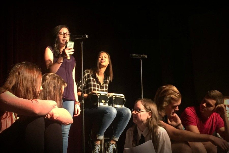 Maria McFarland and Kala Wooten kicked off the Poetry Slam with a poem called Hashtag.