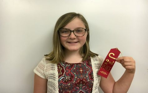Alexis Franks shows off her second place ribbon.