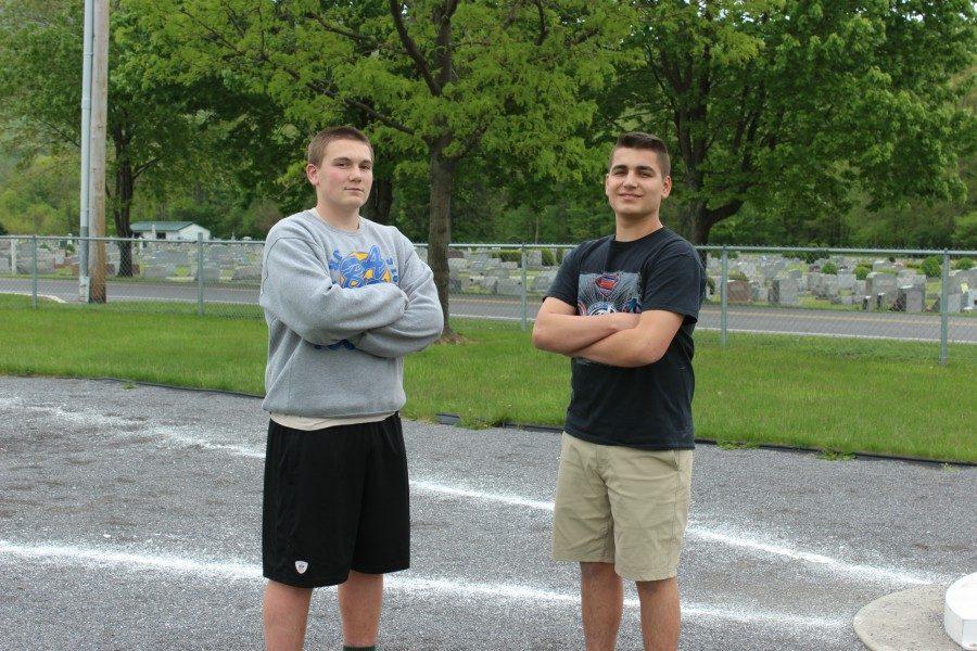 Freshmen Jordan Moore and Dominic Tornatore are two members of the Blue Devil Pit Crew.