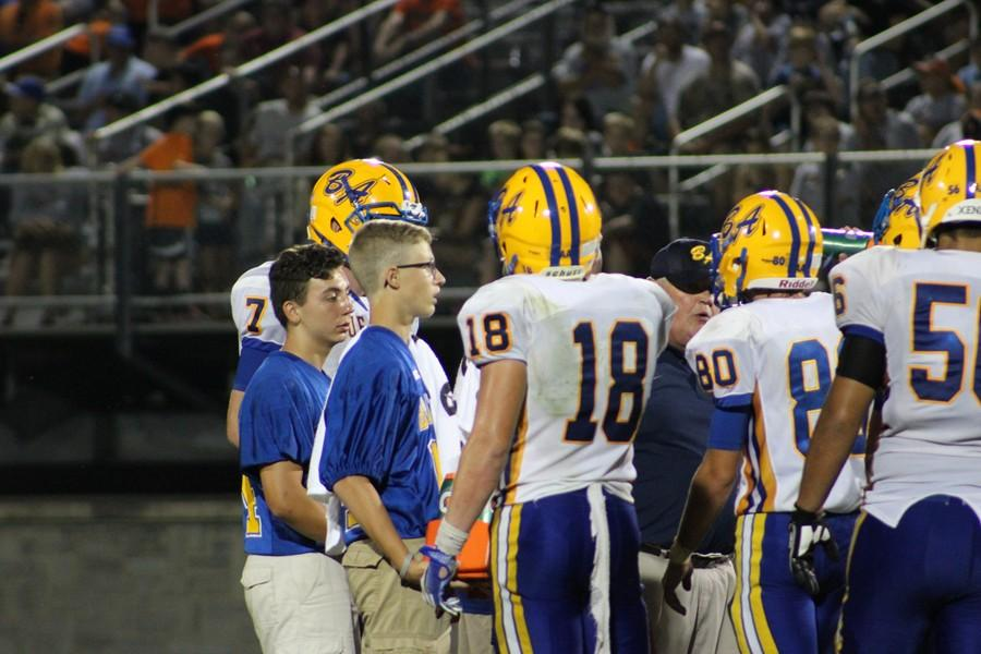 Ethan McGee (18) was once a varsity water boy. Now, junior high players like Lincoln Boyer (left) and Owen Shedlock (right) have filled the role, hoping to one day make it to the varsity level.