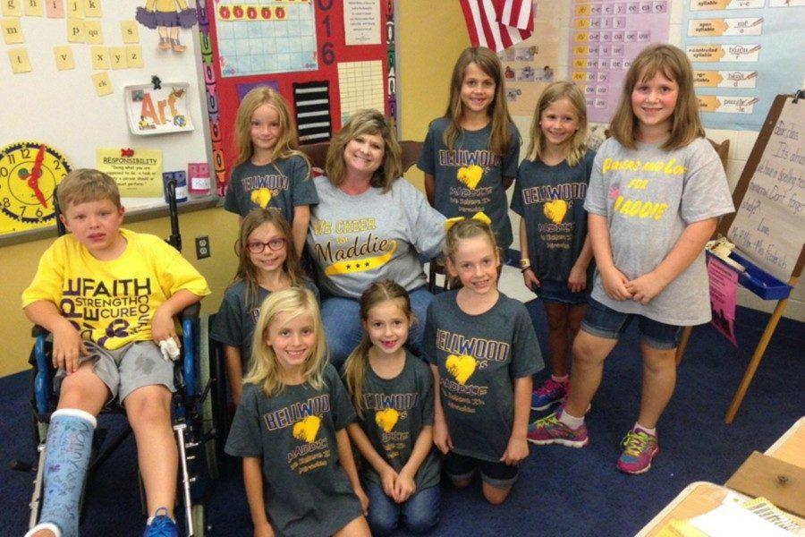 Mrs.+R.Miller+and+some+elementary+students+are+showing+their+support+for+Maddie+by+wearing+Bellwood+loves+Maddie+t-shirts.+
