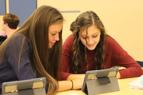 Tina Hollen and Ali Dumin were two members of the student SWAT team that attended iPad training.
