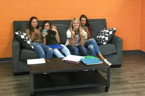 Mikayla Mason, Ali Dumin, Shayla Branstetter, and Kamryn Mercer hang out and relax in the new Media Room.