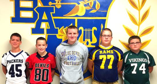 Senior Ryan Beam is surrounded by the next generation of Bellwood football players.
