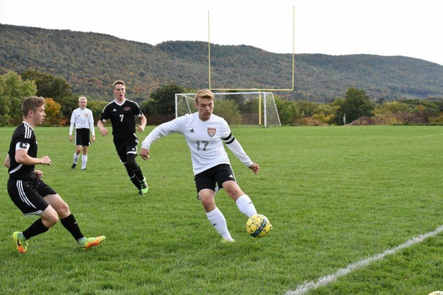 Senior+Aaron+Andrews+works+the+ball+along+the+sideline+against+Penns+Valley.