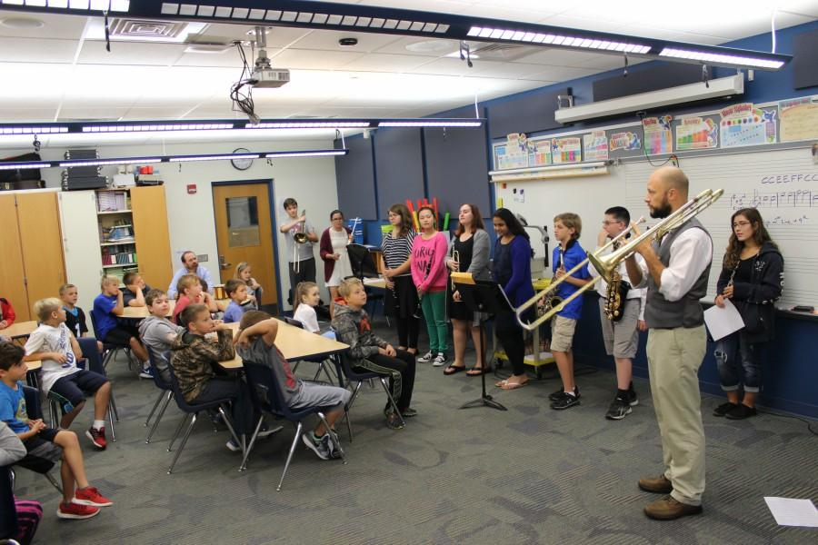 Mr. Sachse and his high school band students give Myers kids a free show.