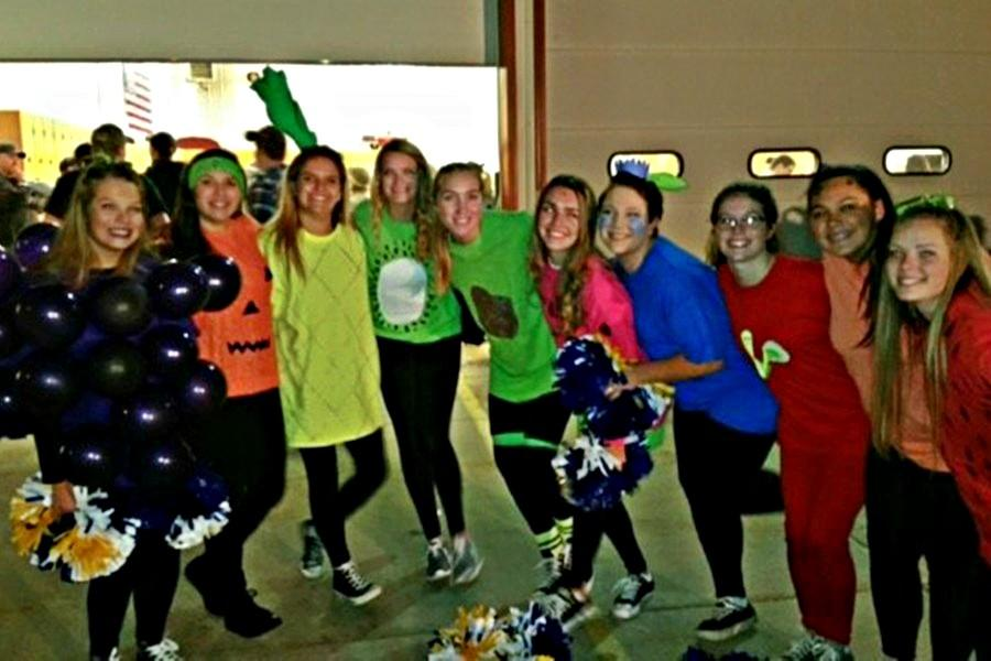 The Bellwod-Antis cheerleaders dressed as fruit for the Bellwood Halloween parade on Tuesday.