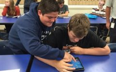 BAMS students help each other during the iPad deployment.
