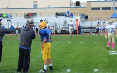 Coach Burch sends in a play with quarterback Trevor Miller.