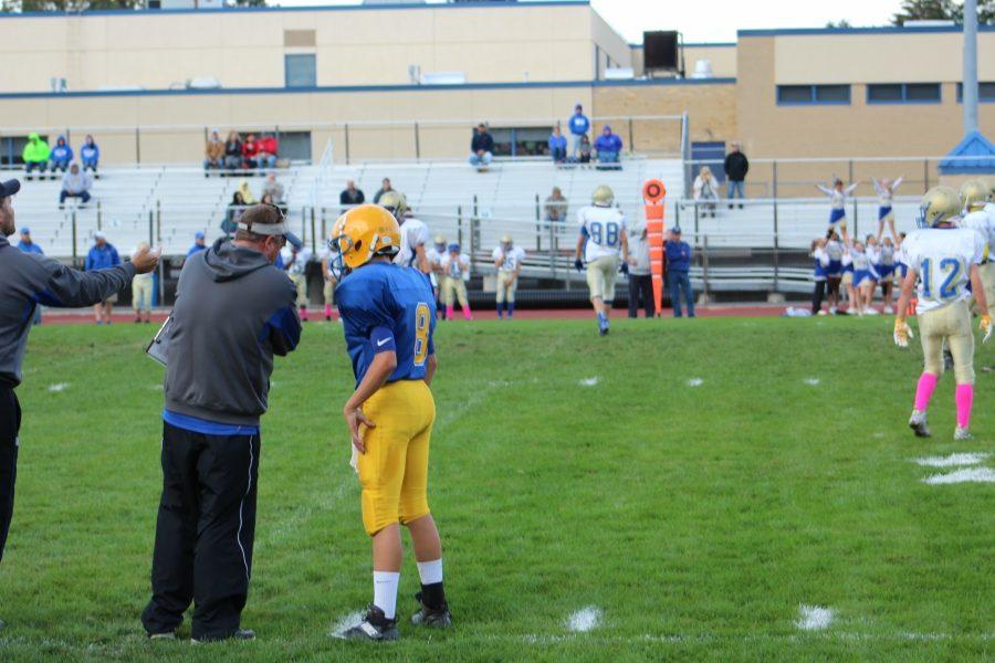 Coach+Burch+sends+in+a+play+with+quarterback+Trevor+Miller.