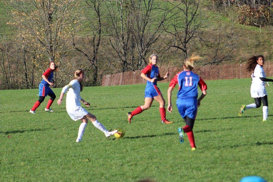 Riley D'Angelo makes a play on a ball near midfield.
