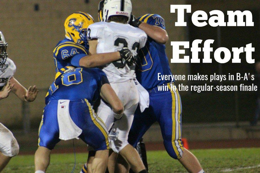 Ethan McGee, Adam Bowers and Jarryd Kissell combine to make a stop in Fridays win over Northern Bedford.