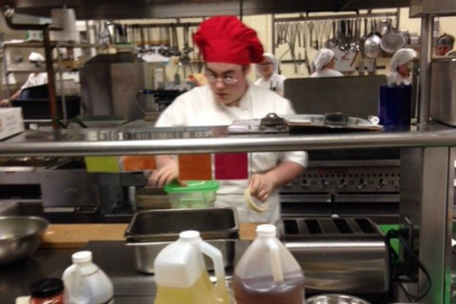 A student in the GACTC culinary arts program prepares a meal during B-As field trip on Tuesday.