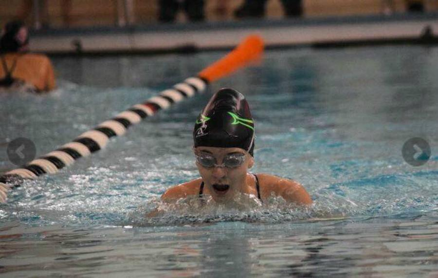 Gwen Daughterty races to the finish line in the breast stroke.