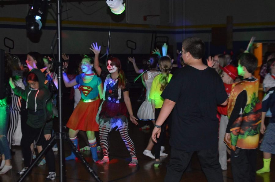 Students dancing at the Haunted Hall event.