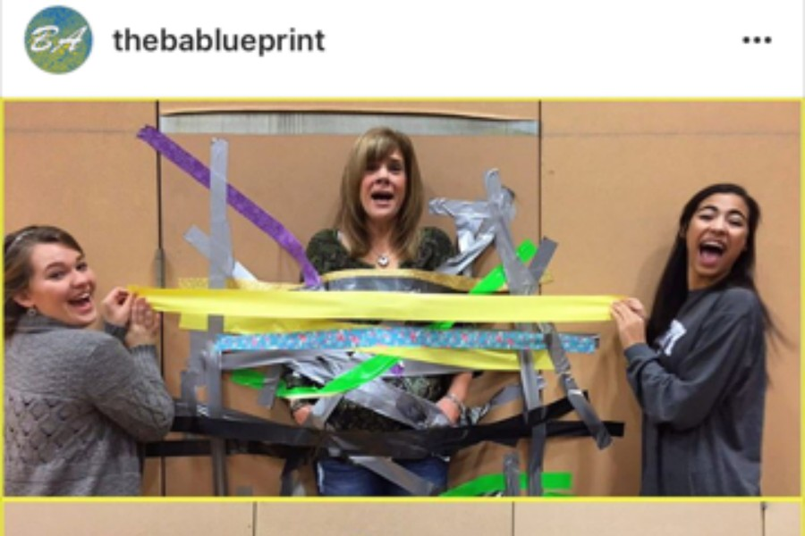 Last year, Mrs. Adams ended up taped to the wall at the annual Activity Fair.