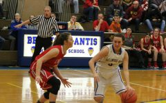 Alanna Leidig looks for room to drive in the Lady Devils win last night over Everett.