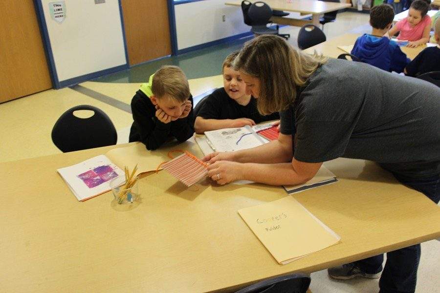 Mrs. Berliner works with students in her Studio Art class at Myers.