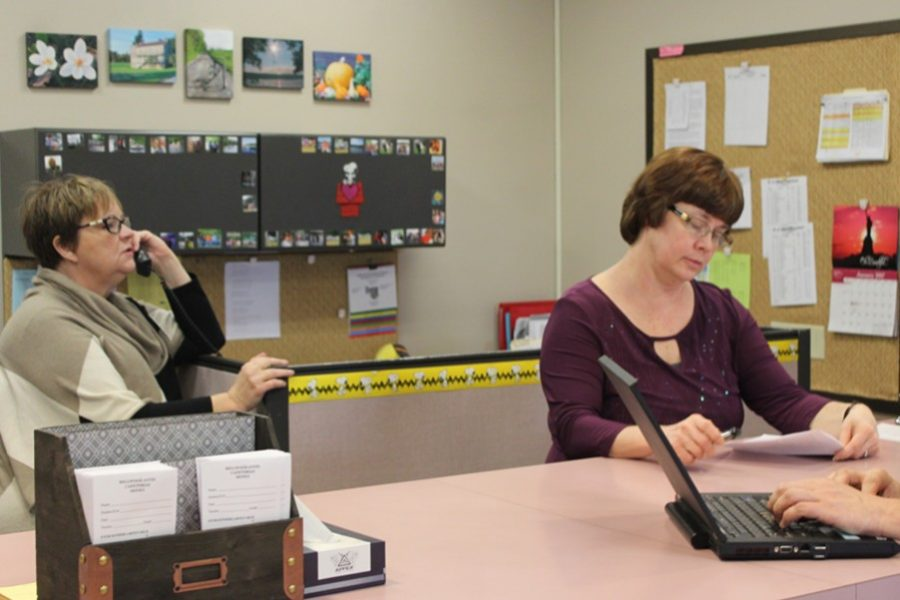 Mrs. Shoop and Mrs. Chamberlain are always busy in the main office.