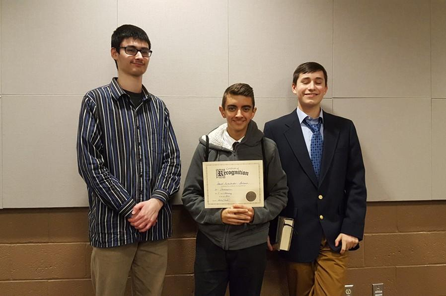 Dan Kustaborder, flanked by Zion Poe (left) and Isaac Patton (right) won the declamation category at District speech.