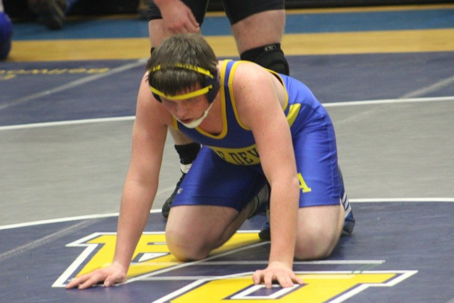 Ryan Kerns takes the down position in his match last night with Tyrone's Levi Raling.