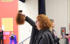 Mrs. Murray had 12 inches of hair cut off at the Childhood Cancer Awareness Week assembly at Myers.