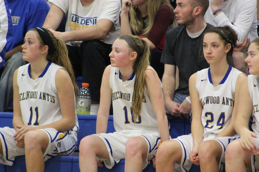 Riley D'Angelo and Sophie Damiano look on from the bench after fouling out in the Lady Blue Devils' loss to Everett Saturday in the ICC championship.