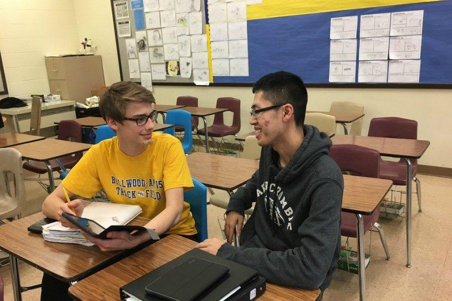 Senior+Devon+Zheng%2C+right%2C+talks+to+classmate+Tanner+George+between+classes.+Devon+isn%27t+a+proponent+of+the+Trump+Wall.