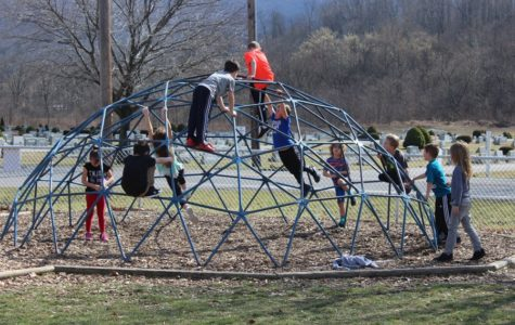 Children at Myers play at recess during the recent February heat wave.