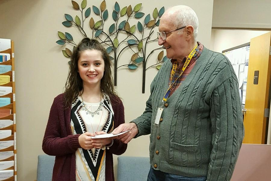 Giovanna Caracciolo accepts her award from Lions Club president Don Mills.