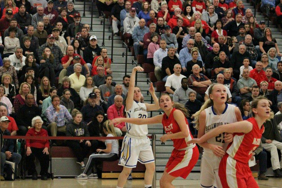 Freshman Emilie Leidig launches one of her three three-pointers as Alli Campbell maneuvers for a rebound in B-A's loss to Bishop McCort in the PIAA semifinals.