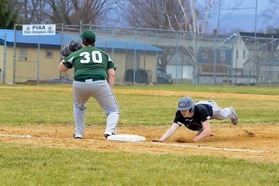Joe Padula gets back safely to first base following a pick-off move.