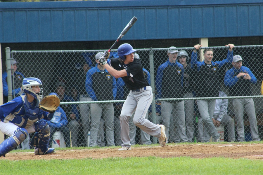 Senior Brendan Kowalski prepares to swing in an at-bat against Mount Union.