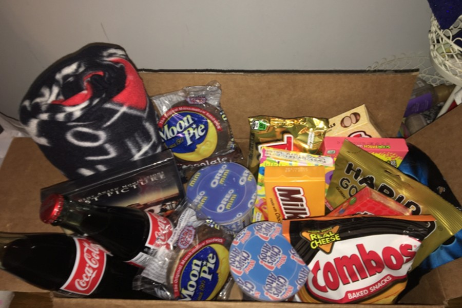 Senior Allison McCaulley used a box of her boyfriend's favorite things as part of her promposal.