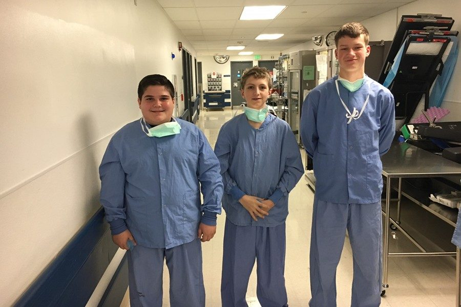 Nick+Caracciolo%2C+Noah+Patton+and+Zach+Mallon+don+their+scrubs+to+prepare+for+job+shadowing+at+UPMC.