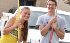 Tina Hollen, posing with Brendan Kowalski, is steadily improving in the javelin.