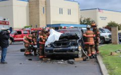 Fire Department volunteers show students the dangers of reckless driving on the road.