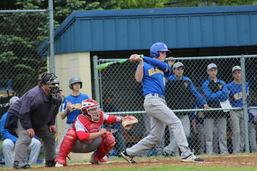 Trent Walker smacks one of his two hits against Everett.
