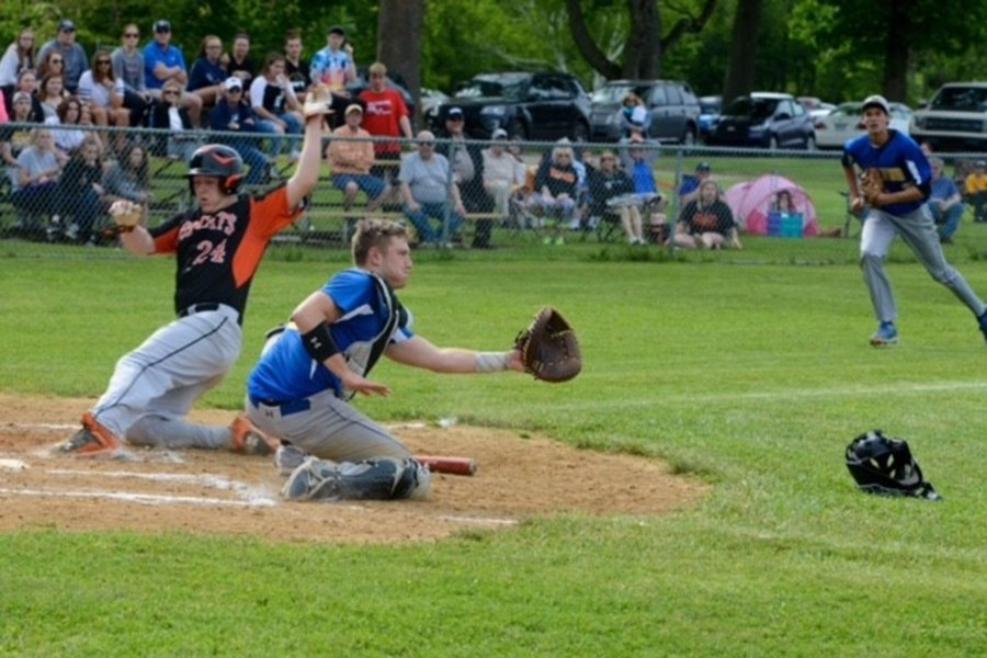Sawyer Kline looks to make a play at the plate yesterday against Blairsville.