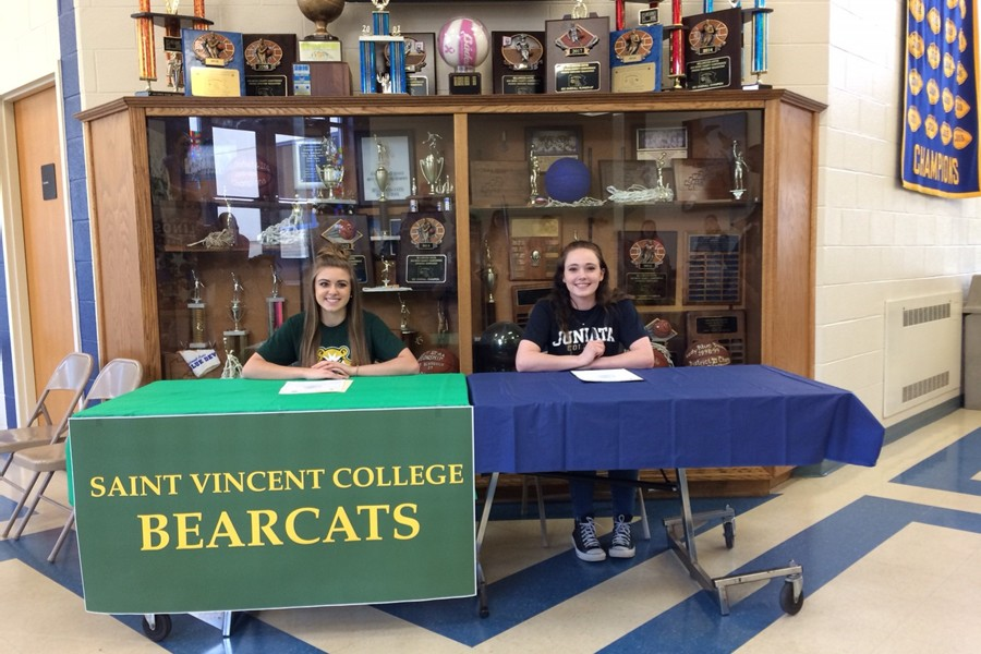 Lindsey+Southworth+%28left%29+and+Makayla+Carles+%28right%29+signed+to+play+their+favorite+sports+in+college+last+Friday.