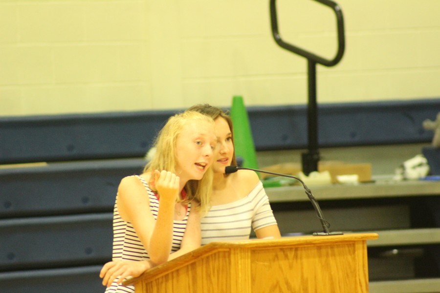 Leo Club members Jenna Bartlett and Alivia Jacobs serve as the emcees at Skit Night.