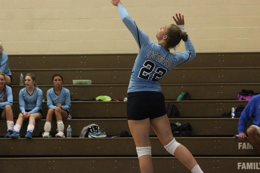 Sakeria Haralson serves the ball against Williamsburg.